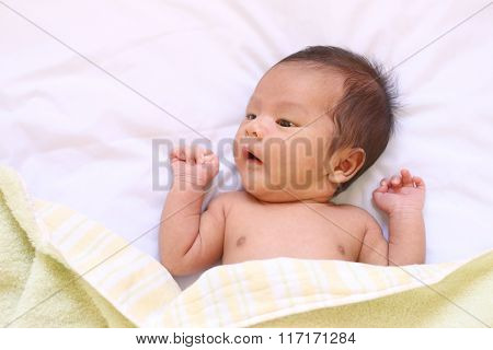 Newborn Baby Of Asia Relax In A Good Mood On White Bed.