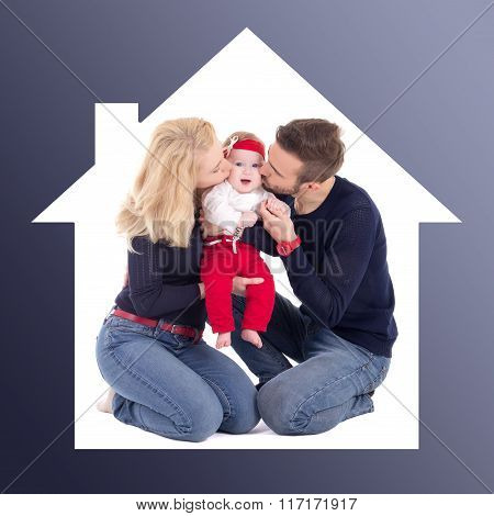 Family Concept - Father And Mother Kissing Little Daughter In House Frame