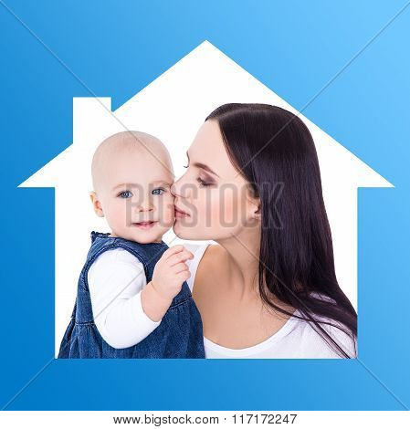 Home Concept - Portrait Of Happy Mother Kissing Little Daughter