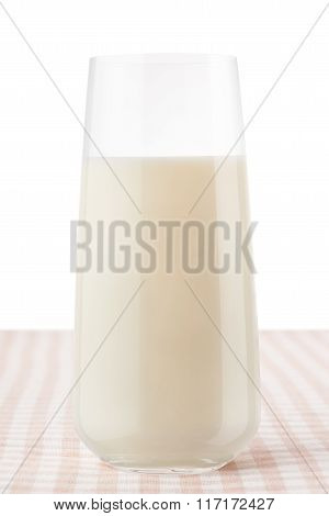 Glass Of Milk On Classic Brown And White Checkered Tablecloth