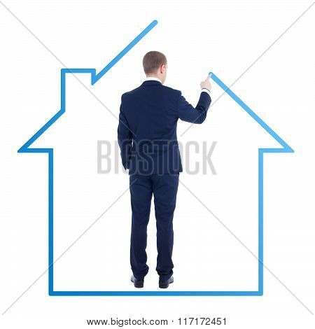 Architecture Or Real Estate Concept - Back View Of Young Business Man Drawing House Isolated On Whit