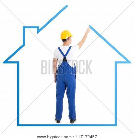 Construction Concept - Man In Blue Builder Uniform Drawing House Isolated On White