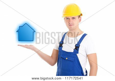 Construction Concept - Man Builder In Uniform And Helmet Holding Little House On Palm Isolated On Wh