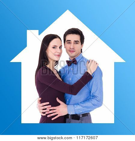Home Concept - Portrait Of Happy Young Couple