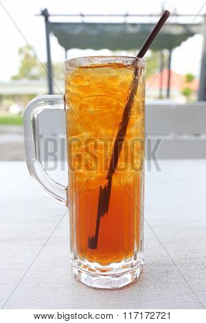 Iced Tea And White Tube In Glass.