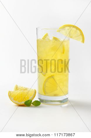 glass of fresh lemon juice with ice on white background