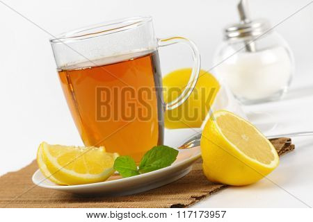cup of black tea with lemon and sugar - close up