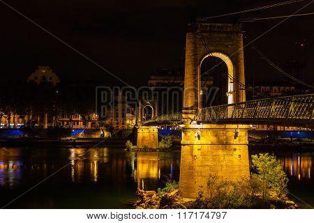 Bridge Over Rhone River In Lyon, France At Night