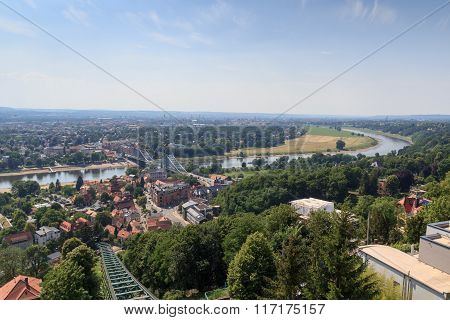 View Of Dresden Cityscape With Dresden Suspension Railway Tracks, River Elbe And Church Frauenkirche