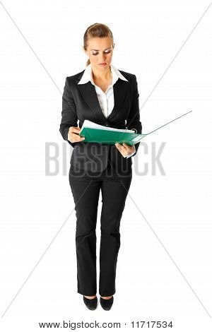 Full length portrait of serious modern business woman exploring documents isolated on white