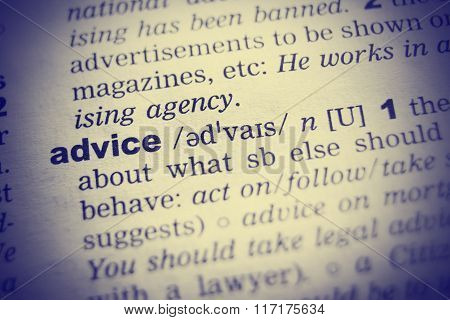 Close up of English dictionary page with word advice
