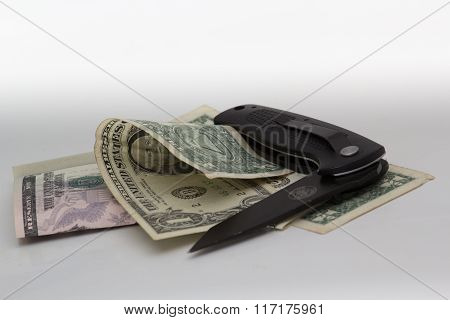 Money And Knife On White Background.