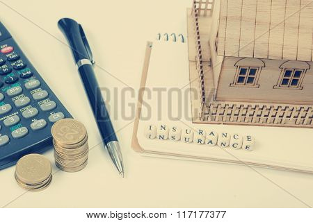 Concept of housing purchase and insurance. Office desk table with supplies top view. Calculator. gol
