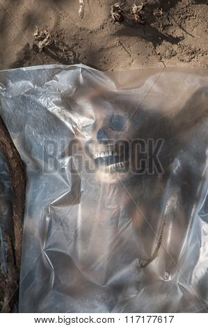 Skeleton wrapped in a plastic bag.
