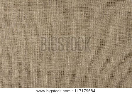Linen tablecloth. Brown canvas background.