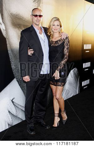 Brooke Burns and Gavin O'Connor at the Los Angeles premiere of