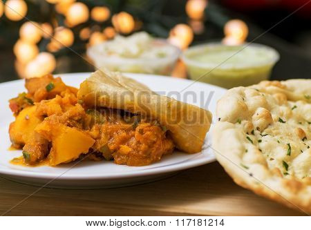 Aloo chaat with naan bread