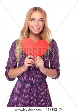 Cute girl with red paper heart in hands isolated on white background, symbol of health and love, celebrating Valentine day