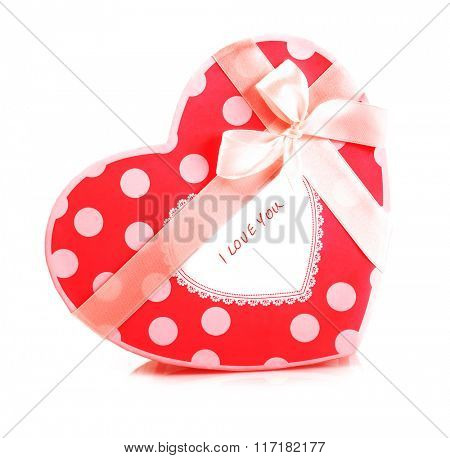 Picture of beautiful red heart-shaped gift-box isolated on white background, romantic present with decorative ribbon bow, Valentine day, symbolic container for holiday sweets, love concept