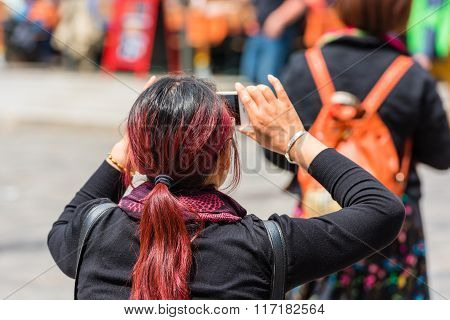 Back Side Of Young Woman Taking A Photo