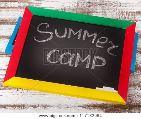 Blackboard with text it's Summer camp, Chalkboard style typographic design Summercamp.