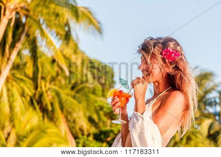 outdoor portrait of young happy girl on tropical sea background, holiday image