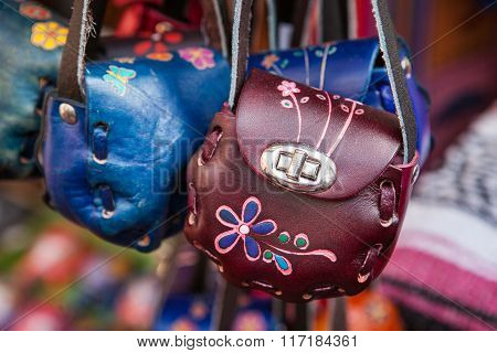 Hand made colorful leather little bags in Mexican market