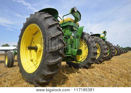 Lineup of old restored John Deere tractors