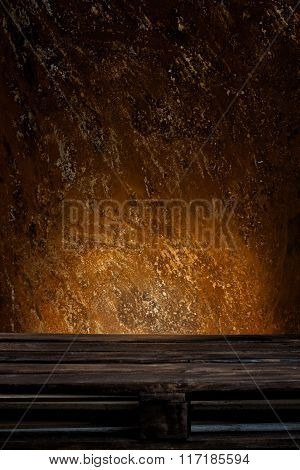 Wooden palette in front of rusty background