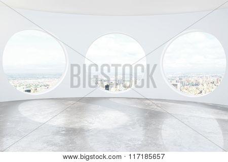 Light Loft Room With Round Windows And Concrete Floor