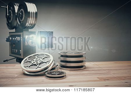 Vintage Old Movie Camera And Film Cartridge On A Wooden Table