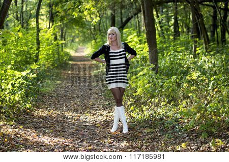The Beautiful Blonde In White Boots On A Forest Footpath, Fall