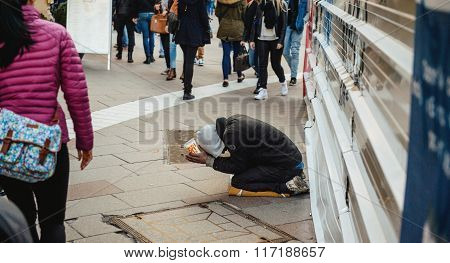 Beggar In The Street Of France