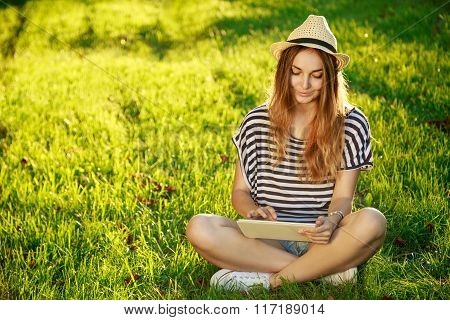 Happy Hipster Girl Using Tablet Outdoors