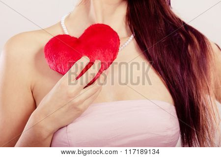 Woman Holds Red Heart In Hand Closeup