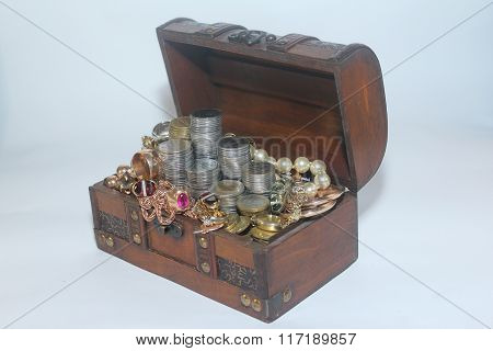 Coins and gold in an old trunk