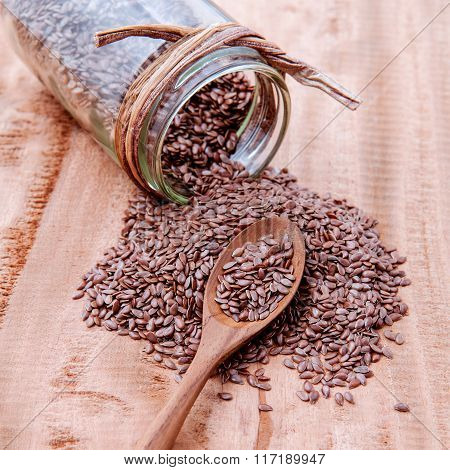Alternative Health Care And Dieting Flax Seeds In Wooden Spoon Set Up On Rustic Wooden Background.