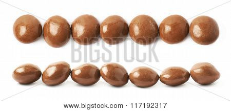 Chocolate glazed nut candies isolated