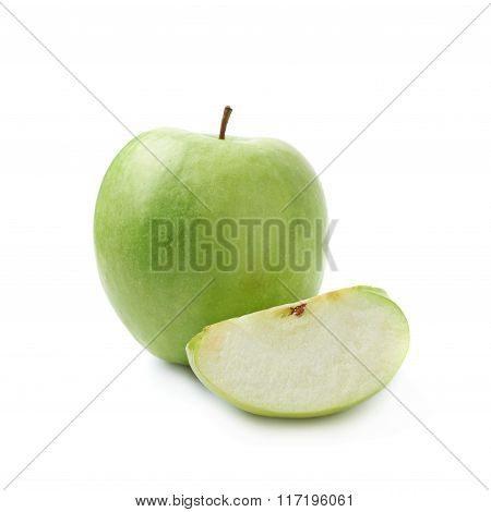 Green apple next to a slice isolated