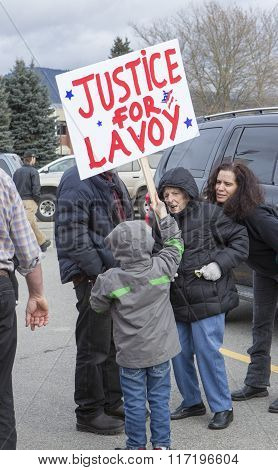 Young Boy Holds Sign.