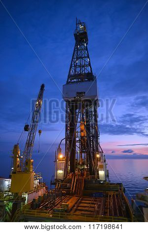 Derrick of jack up oil rig with twilight sky in the Guld of Thailand