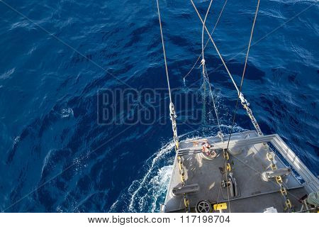 Jack up oil rig bow floating on the blue ocean water in rig move operation