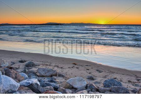 Ventura sunset behind the breaking waves.