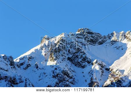 Mountains Against The Blue Sky