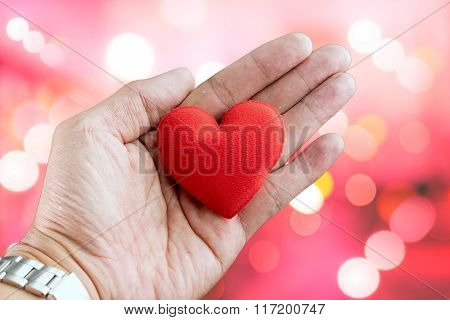 Heart symbol in hand