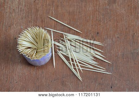 toothpick in box container on wooden board