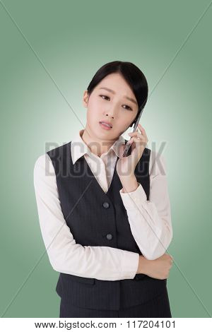 unhappy or worried business woman using phone