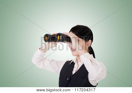 asian business woman holding a binoculars, closeup portrait