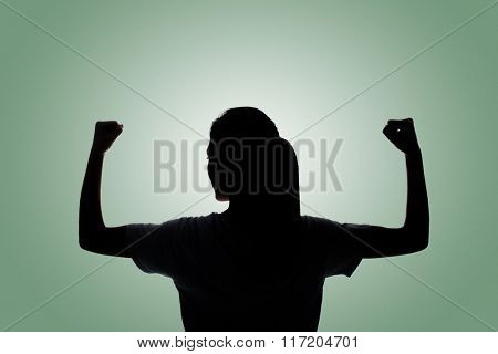 Rear view of confident Asian woman of Silhouette.