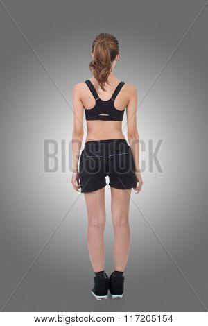 Rear view of Asian sport girl, full length portrait isolated on white background.